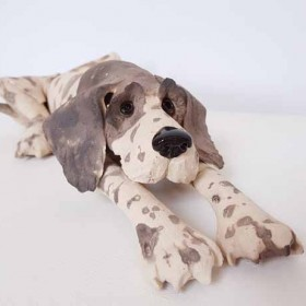 Lying Dog , sculpture by Virginia Dowe Edwards